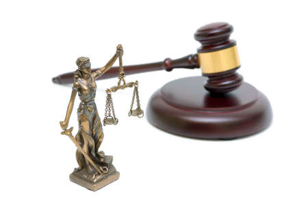 statue of justice and gavel on white background close-up. horizontal photo. photo