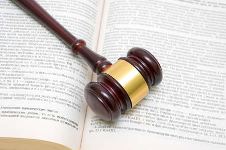 judges gavel on an open book of laws of the Russian Federation. top view - horizontal photo.