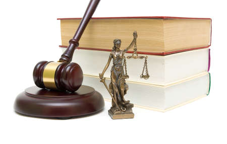 statue of justice, gavel and stack of books isolated on white background close-up. horizontal photo.