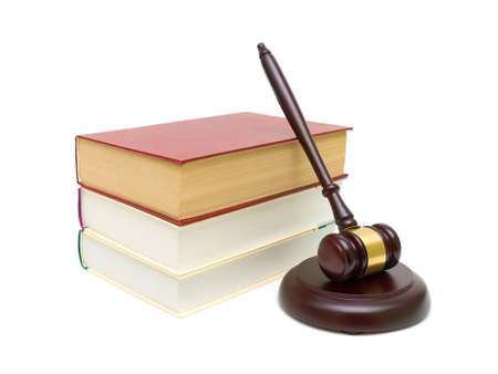 gavel and stack of books isolated on white background close-up. horizontal photo.