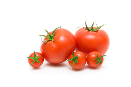 ripe tomatoes of different varieties on a white background close-up. horizontal photo. Stock Photo