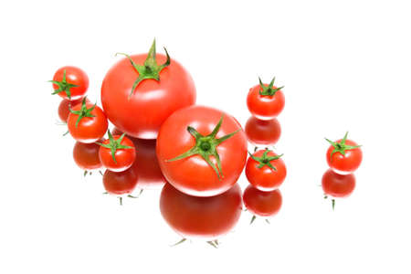 Fresh ripe tomatoes on a white  photo