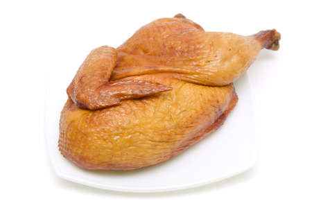 roasted chicken on a plate close up isolated on a white Stock Photo