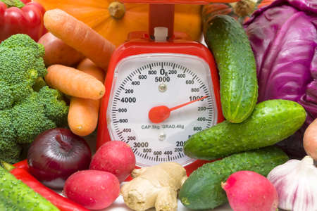 Kitchen scales and fresh vegetables close-up. horizontal photo. photo