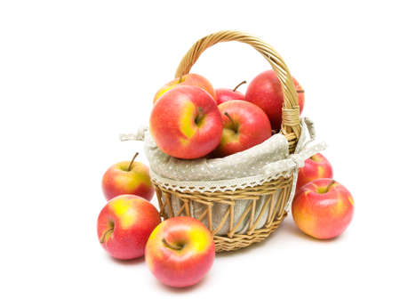 juicy ripe red apples in a basket on a white background close-up. horizontal photo.