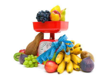 red gram: fresh fruit, kitchen scales and measuring tape on a white background close. horizontal photo.