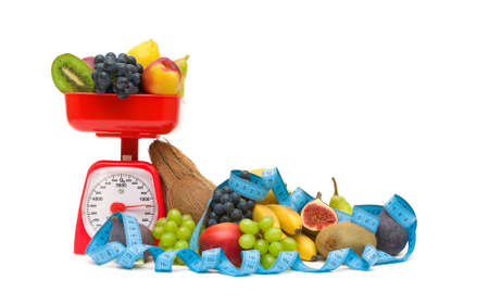 kitchen scales, fresh ripe fruits and measuring tape isolated on a white background. horizontal photo. photo