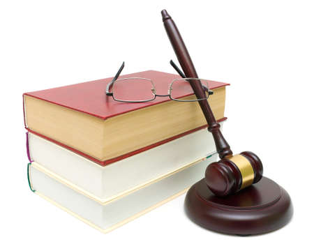 gavel, a stack of books and glasses closeup isolated on a white background. horizontal photo.