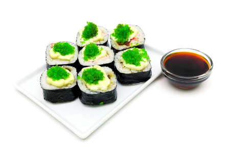 Japanese rolls and soy sauce isolated on a white background close-up. horizontal photo.