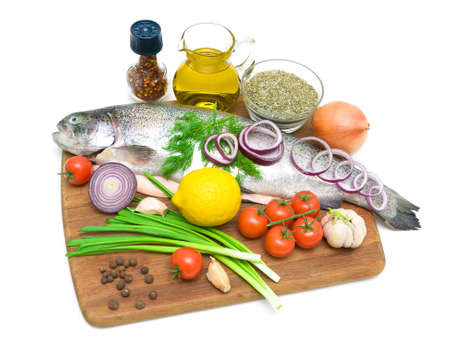 trout and different food on a cutting board on a white background. horizontal photo. photo