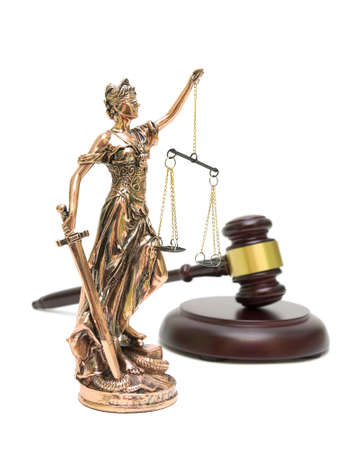 statue of justice and gavel isolated on white background. horizontal photo. photo