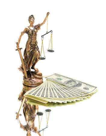 statue of justice and money isolated on white background. vertical photo. photo