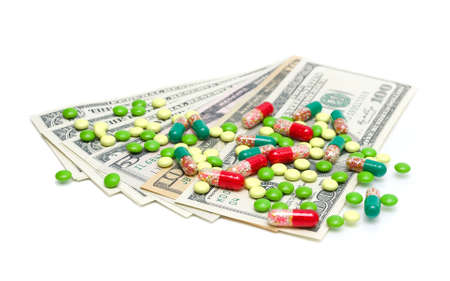money (U.S. dollars) and medical drugs on white background close-up. horizontal photo. photo