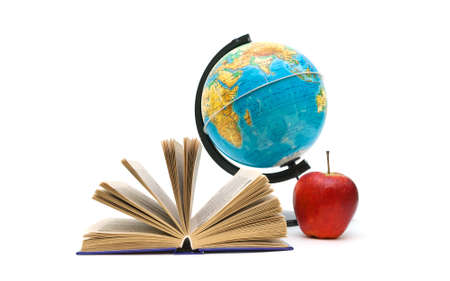 open book, globe and red apple on a white background.  photo