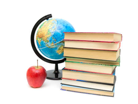 red apple, stack of books and globe on white background.  photo