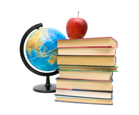 globe, stack of books and red apple close up isolated on a white background. photo