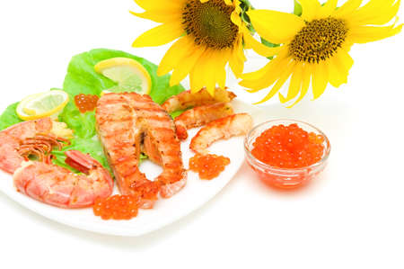 Salmon grilled steak, grilled shrimp and red caviar on a white background close-up. horizontal photo. photo