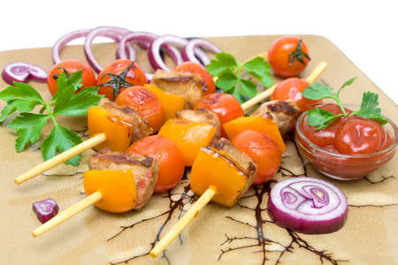 kebab with vegetables and greens on a plate closeup. horizontal photo. photo