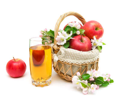 ripe red apples and glass of apple juice isolated on white background. horizontal photo. photo