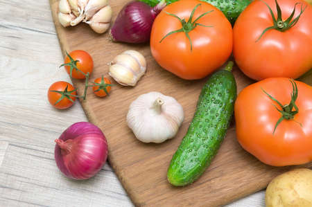 fresh vegetables closeup on wooden background. horizontal photo.