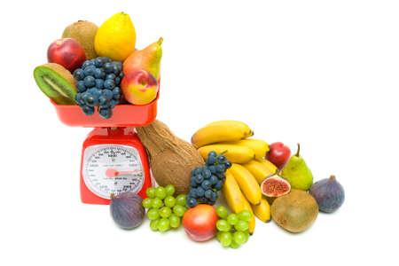 Healthy Eating: Fresh fruits and kitchen scale on white background. horizontal photo. photo