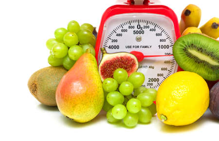 red gram: fresh fruit and kitchen scales close up on a white background. horizontal photo.