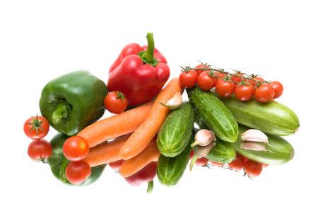 fresh vegetables on the mirror surface. white background - horizontal photo. photo