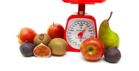 fresh fruit and kitchen scales close up on a white background. horizontal photo. photo
