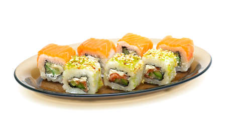 Japanese cuisine: rolls on a plate isolated on a white background