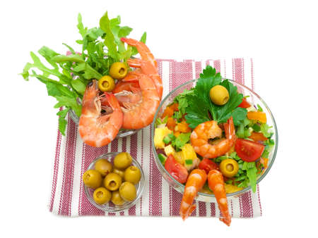 vegetable salad with shrimps closeup on a white background. top view - horizontal photo. photo