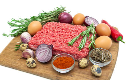 minced meat of beef and different foods closeup on white background. horizontal photo. photo