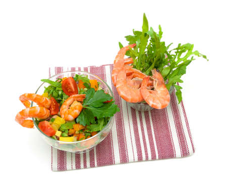 fresh vegetable salad with shrimp on a white background. horizontal photo.