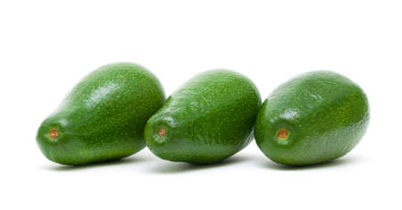 three ripe avocado closeup isolated on a white background. horizontal photo. photo