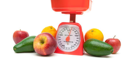 red gram: healthy food: fruits and kitchen scale on white background.