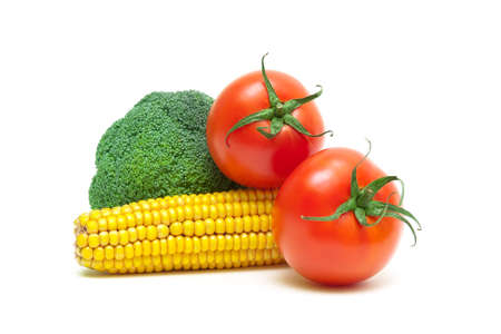 tomatoes, corn and broccoli isolated on white background close-up. horizontal photo. photo