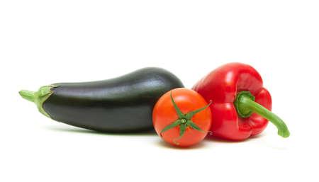 tomato, sweet peppers and eggplant isolated on white background close up. horizontal photo. photo