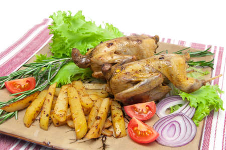 appetizing carcass woodcock with vegetables on a plate close-up. horizontal photo. photo
