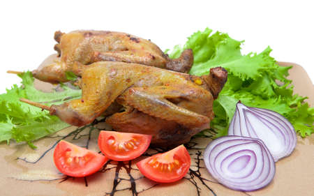 trophies: delicious roasted woodcocks with fresh vegetables. horizontal photo. photo