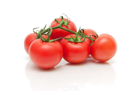 ripe fresh tomatoes closeup on a white background. horizontal photo. Stock Photo