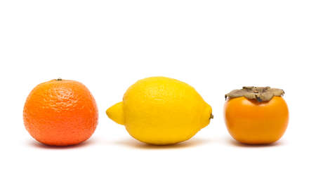 lemon, persimmon and tangerine isolated on white background. horizontal photo.