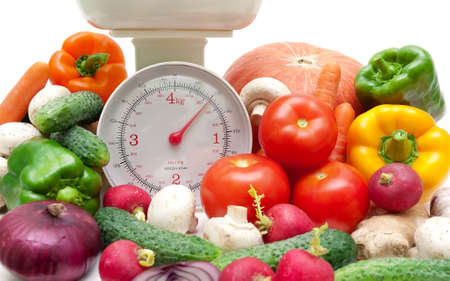fresh vegetables and kitchen scale closeup photo