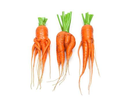 irregularly shaped carrots close-up isolated on white background. horizontal photo.