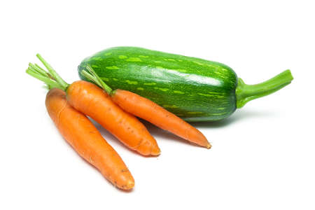fresh carrots and zucchini isolated on a white background. Horizontal photo.