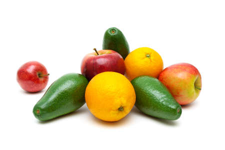 apples and oranges: ripe apples, oranges and avocados on a white background. horizontal photo. Stock Photo