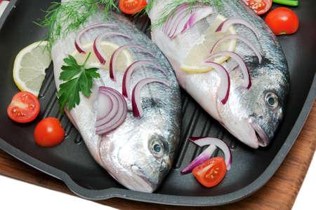 dorado fish: Dorado fish, vegetables and herbs in a pan. horizontal photo.