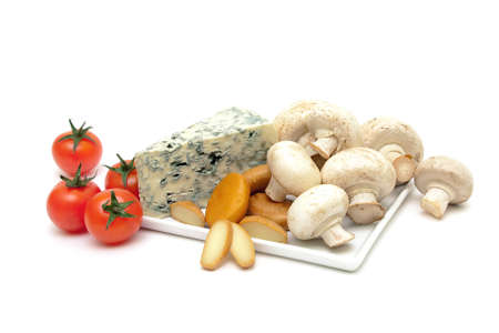 champignon mushrooms, cherry tomatoes and cheese close-up on a white background. horizontal photo. Stock Photo