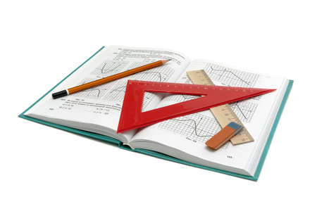 math book and office supplies on a white background. horizontal photo.