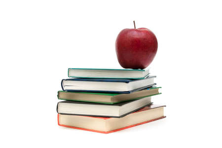 stack of books and red apple on a white background. horizontal photo. Stock Photo