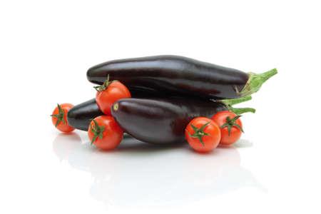 ripe cherry tomatoes and eggplant close-up on white background. horizontal photo.