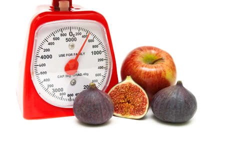 kitchen scale, fig and apple on a white background. horizontal photo. Stock Photo
